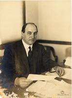 John Mitchell seated at desk (1)