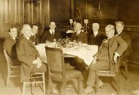 Unidentifed group of eight men around a table