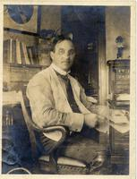 John Mitchell seated at desk (2)