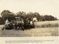 Farmer on a horse drawn combine