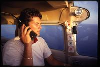A Brothers to the Rescue pilot flies over the Straits of Florida during a rescue mission, Miami, Florida