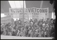 """""""Victory for the Viet Cong: Defeat imperialism everywhere""""; Members of the Revolutionary Contingent hold banners under the counter-inaugural tent during a rally against Nixon's inauguration and the Vietnam War, 19 January 1969"""