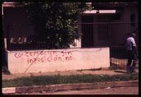 """Concertacion sin imposición no"" written on wall in Managua"