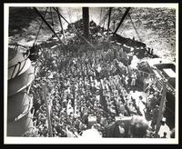 Coast Guardsmen and Marines on boat deck at Lenten Mass