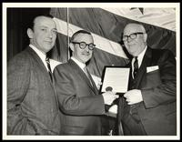 Felix Grant, Robert E. McLaughlin and unidentified man hold proclamation