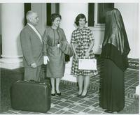 A student, her parents, and a nun