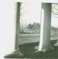 Behind the columns on the Main House