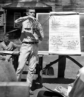 Peace Corps Volunteer Larry Recter gives a lecture on crop production, Caburgua, Chile