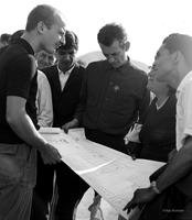Peace Corps Volunteer Dave Fisk (center) going over plans for new houses with the Junta de Vecinos at Población Colo Colo, Nueva Palena, Chile